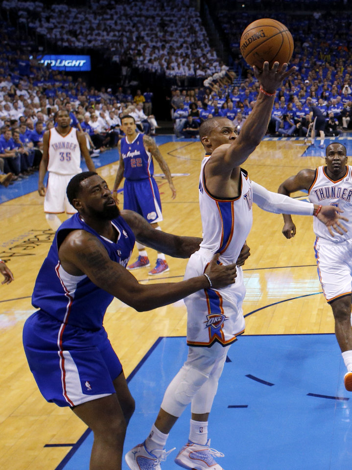 Photo - Oklahoma City's Russell Westbrook (0) is fouled by Los Angeles' DeAndre Jordan (6) during Game 2 of the Western Conference semifinals in the NBA playoffs between the Oklahoma City Thunder and the Los Angeles Clippers at Chesapeake Energy Arena in Oklahoma City, Wednesday, May 7, 2014. Photo by Bryan Terry, The Oklahoman