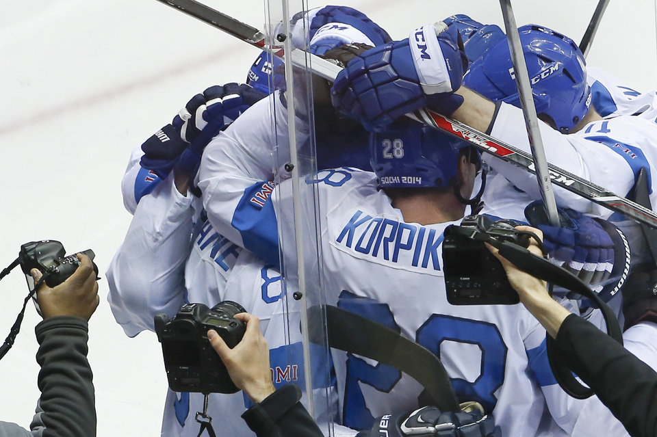 Photo - Team Finland celebrates Teemu Selanne's goal against the United States during the second period of the men's bronze medal ice hockey game at the 2014 Winter Olympics, Saturday, Feb. 22, 2014, in Sochi, Russia. (AP Photo/Matt Slocum)