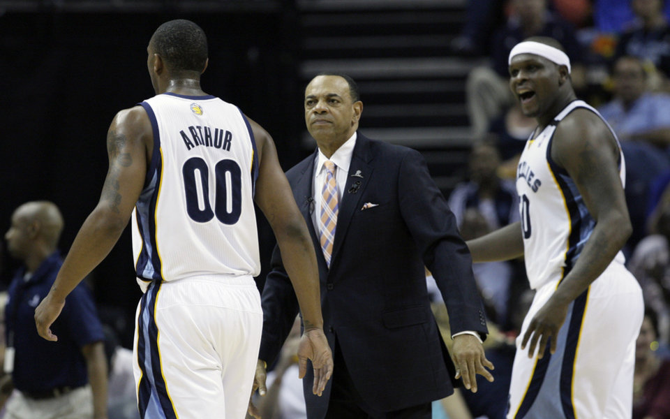 Memphis Grizzlies\' Lionel Hollins watches as Memphis Grizzlies\' Darrell Arthur (00) and Zach Randolph return to the bench during the first half of Game 3 in a first-round NBA basketball playoff series in Memphis, Tenn., Thursday, April 25, 2013. The Grizzlies defeated the Clippers 94-82. (AP Photo/Danny Johnston)