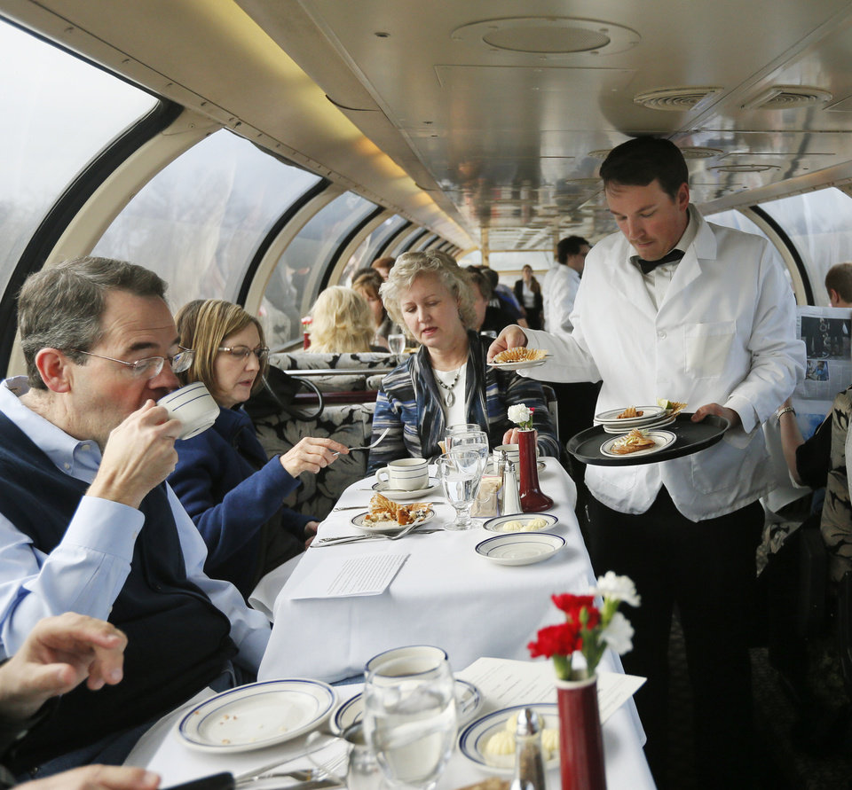 Photo - Passengers are served breakfast in the dome car on a demonstration ride of the Eastern Flyer passenger train from Sapulpa to the Oklahoma City metro area, Sunday, Feb. 23, 2014. Photo by Nate Billings, The Oklahoman