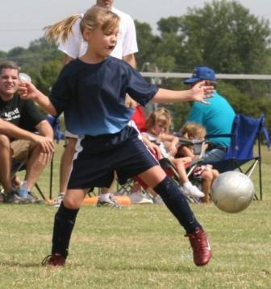Mackenzie McCoy (8) blocking a kick in summer soccer at Lake Overholser<br/><b>Community Photo By:</b> Janna McCoy<br/><b>Submitted By:</b> Janna, Choctaw