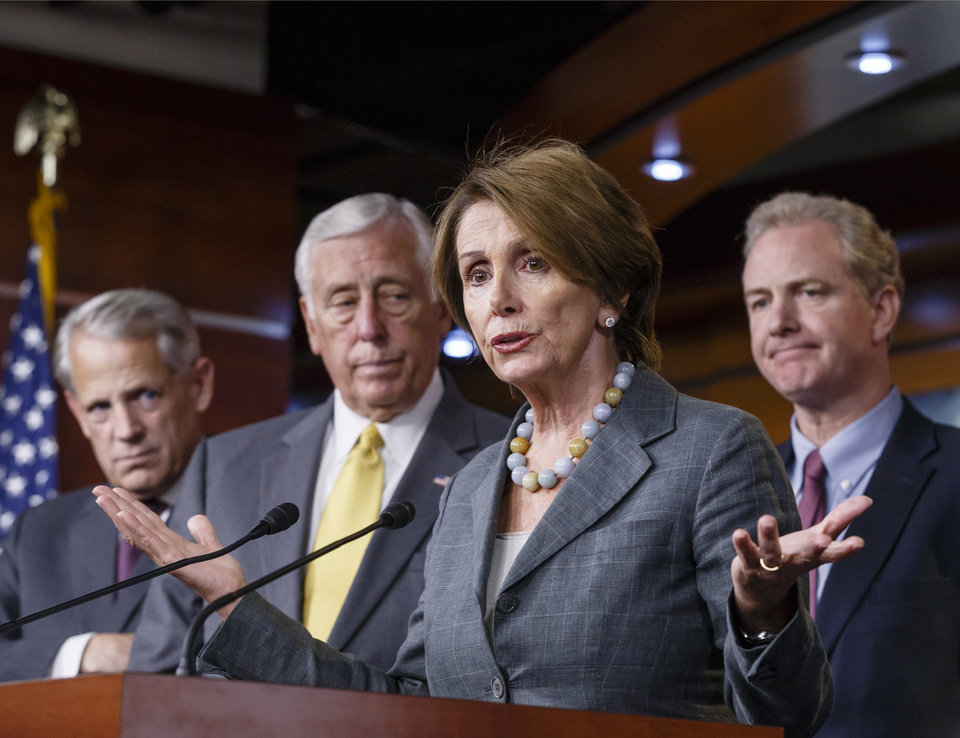 Photo - House Minority Leader Nancy Pelosi, D-Calif., and House Democratic leaders discuss the government shutdown and their disagreement with Speaker of the House John Boehner, R-Ohio, at a news conference at the Capitol in Washington, Saturday, Oct. 5, 2013. There has been no sign of progress toward ending an impasse that has idled 800,000 federal workers and curbed services around the country. From left to right are Rep. Steve Israel, D-N.Y., Minority Whip Steny Hoyer, D-Md., House Minority Leader Nancy Pelosi, D-Calif., and Rep. Chris Van Hollen, D-Md. (AP Photo/J. Scott Applewhite)
