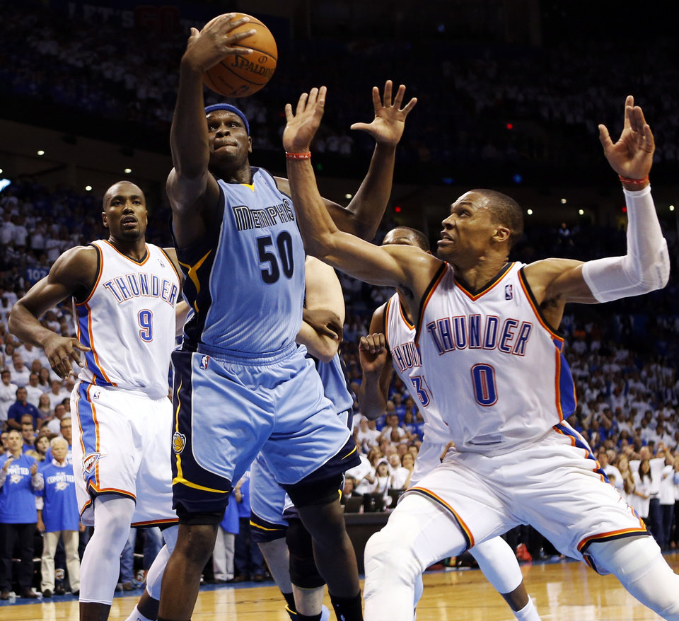 Photo - Memphis' Zach Randolph (50) grabs a rebound between Oklahoma City's Serge Ibaka (9) and Russell Westbrook (0) during Game 2 in the first round of the NBA playoffs between the Oklahoma City Thunder and the Memphis Grizzlies at Chesapeake Energy Arena in Oklahoma City, Monday, April 21, 2014. Memphis won 111-105 in overtime. Photo by Nate Billings, The Oklahoman