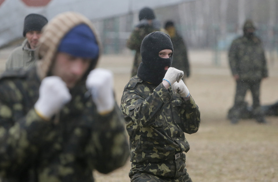 Photo - Self-Defense activists perform military exercises at a military training ground outside Kiev, Ukraine, Monday, March 17, 2014. Ukraine's parliament on Monday voted partial mobilization in response to Russia's invasion onto the Ukrainian territory. (AP Photo/Efrem Lukatsky)