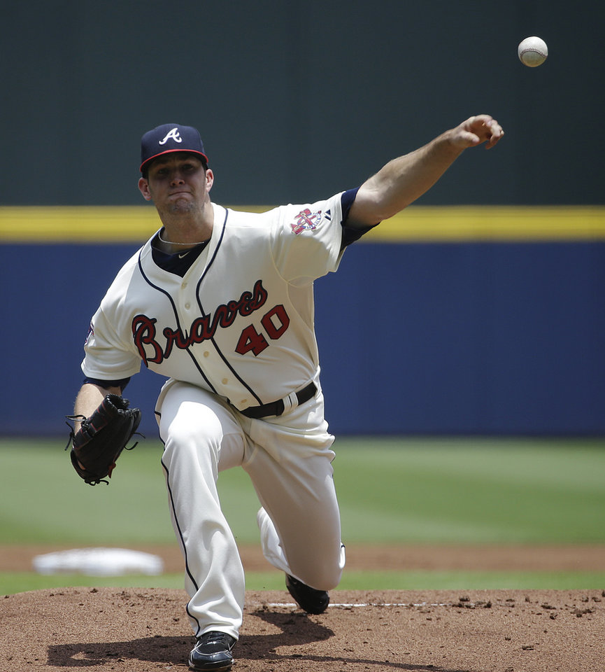 Photo - Atlanta Braves starting pitcher Alex Wood throws in the first inning of a baseball game against the Arizona Diamondbacks, Sunday, July 6, 2014, in Atlanta. (AP Photo/David Goldman)