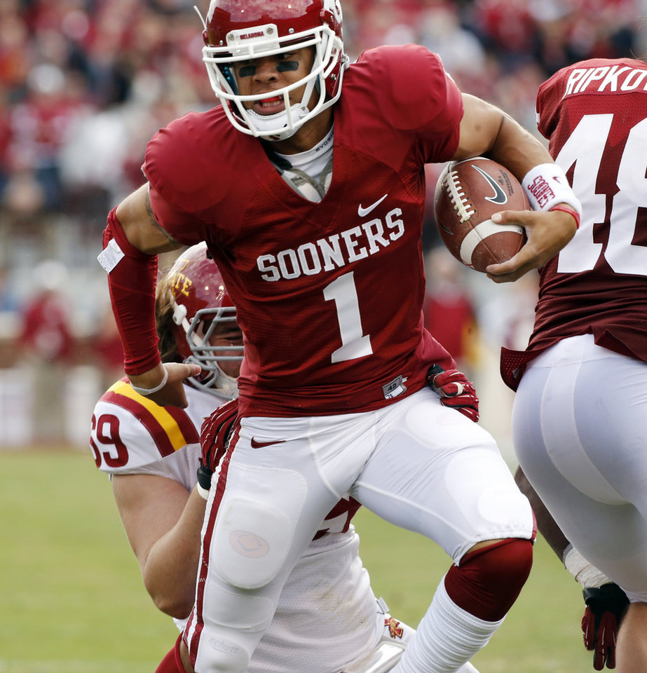 Photo - OU's 2013 home uniform. Worn by receiver Kendall Thompson. PHOTO BY STEVE SISNEY, The Oklahoman