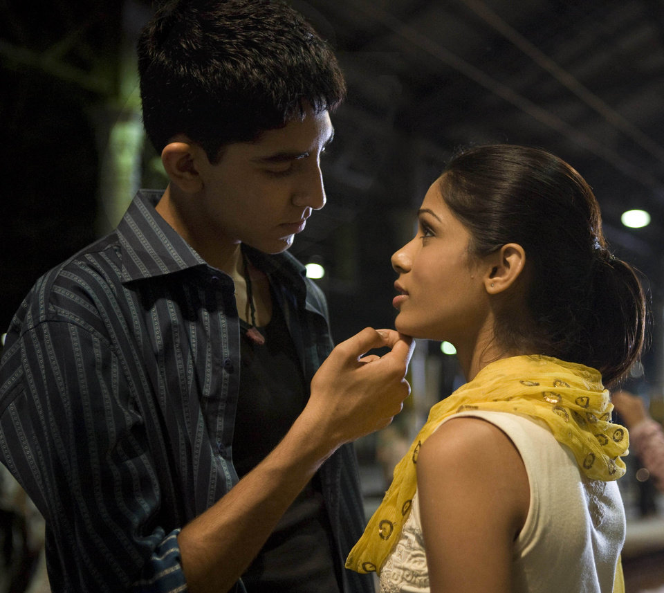 Photo - NOMINEE / NOMINATION / MOVIE: In this image released by Fox Searchlight pictures, Dev Patel, left, and Freida Pinto are shown in a scene from