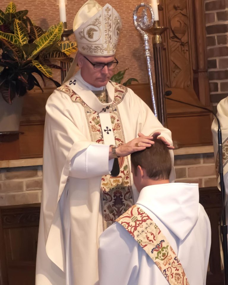 Photo - The Most Rev. Paul S. Coakley, archbishop of the Archdiocese of Oklahoma City, ordains the Rev. Simeon Spitz to the Roman Catholic priesthood during a May 31 ceremony at St. Gregory's Abbey in Shawnee.   Photo by Vincent R. Vitale