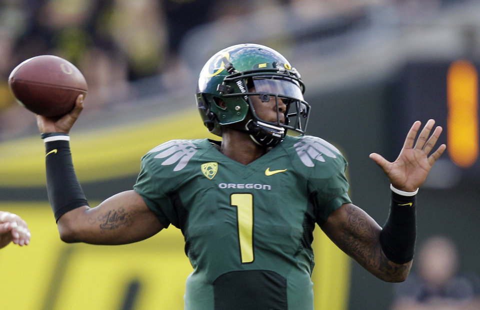 Photo - FILE - In this Oct. 2, 2010, file photo, Oregon quarterback Darron Thomas (1) throws a pass during the first half of an NCAA college football game against Stanford in Eugene, Ore. Before the season started, Thomas was the