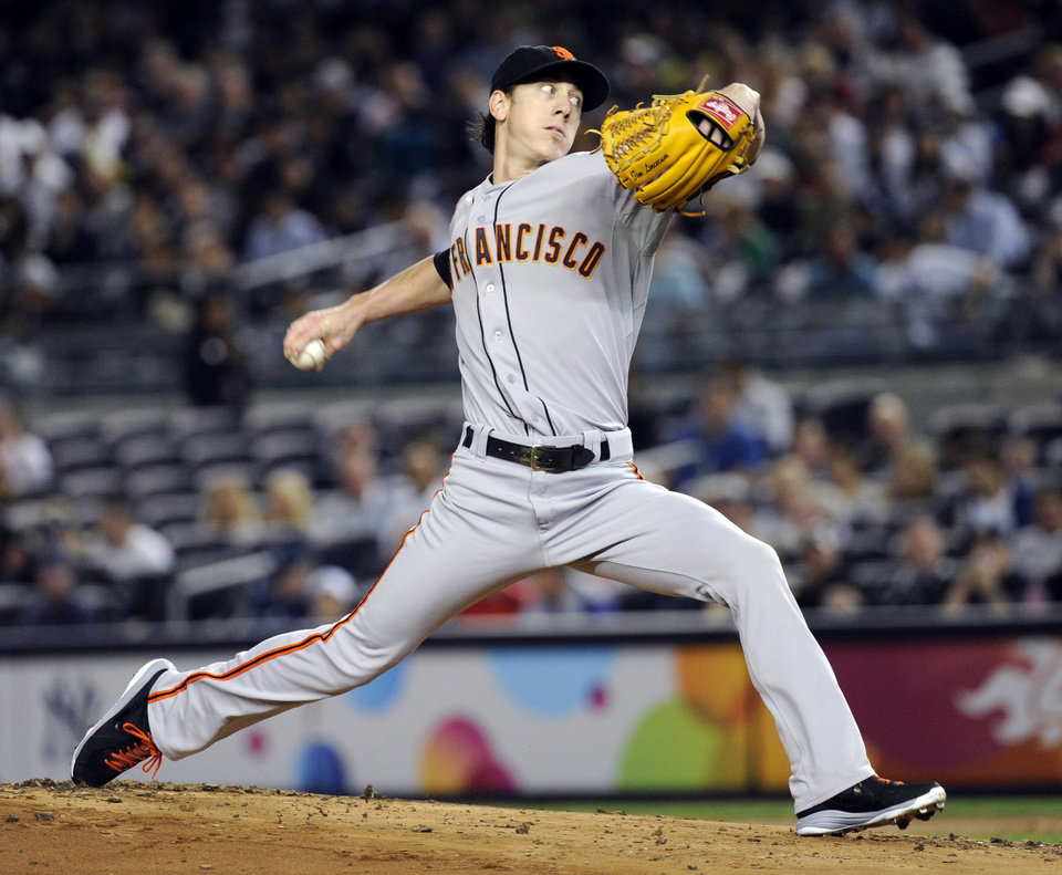 Photo - San Francisco Giants pitcher Tim Lincecum delivers during the first inning of an interleague baseball game against the New York Yankees, Friday, Sept. 20, 2013, at Yankee Stadium in New York. (AP Photo/Bill Kostroun)