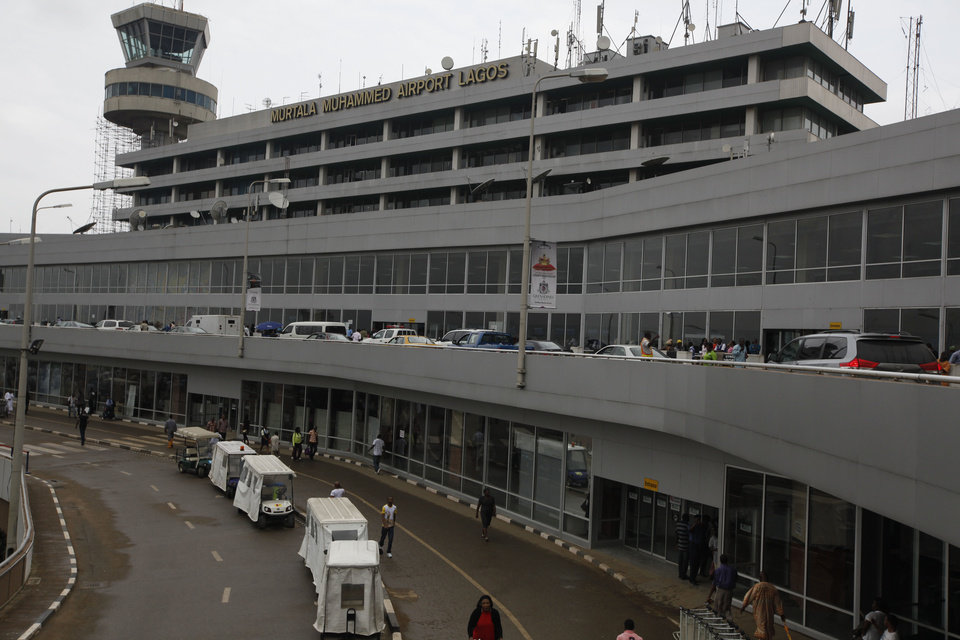Photo - Passengers are seen at the Murtala Muhammed International Airport in Lagos, Nigeria, Monday, Aug. 4, 2014. Nigerian authorities on Monday confirmed a second case of Ebola in Africa's most populous country, an alarming setback as officials across the region battle to stop the spread of a disease that has killed more than 700 people. (AP Photo/Sunday Alamba)
