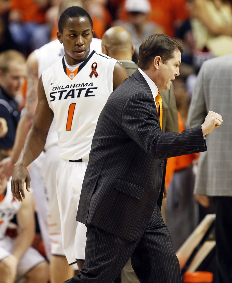 OSU head coach Travis Ford gives instructions to Kirby Gardner (1) during a men\'s college basketball game between Oklahoma State University (OSU) and Texas Tech at Gallagher-Iba Arena in Stillwater, Okla., Saturday, Jan. 19, 2013. Photo by Nate Billings, The Oklahoman