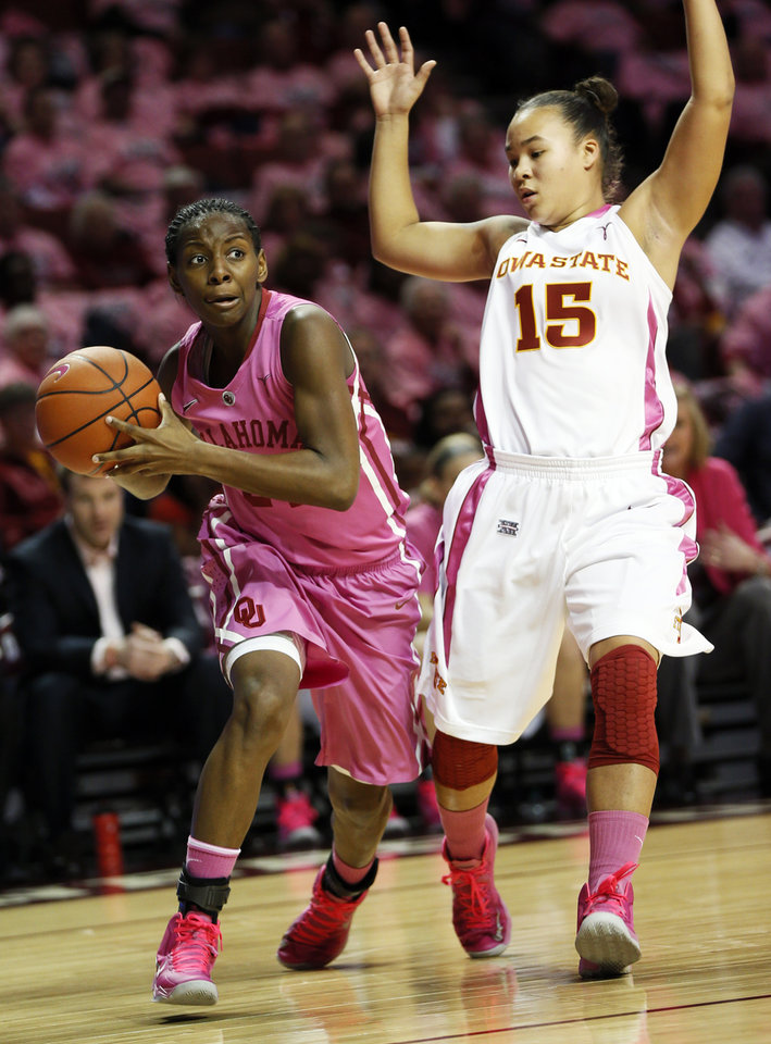 Photo - Oklahoma's Sharane Campbell (24) looks to pass around Iowa State's Nicole