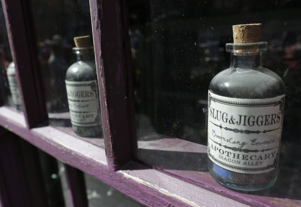 Photo - A window display is seen at the Apothecary during a preview of Diagon Alley at the Wizarding World of Harry Potter at Universal Orlando, Thursday, June 19, 2014, in Orlando, Fla. (AP Photo/John Raoux)