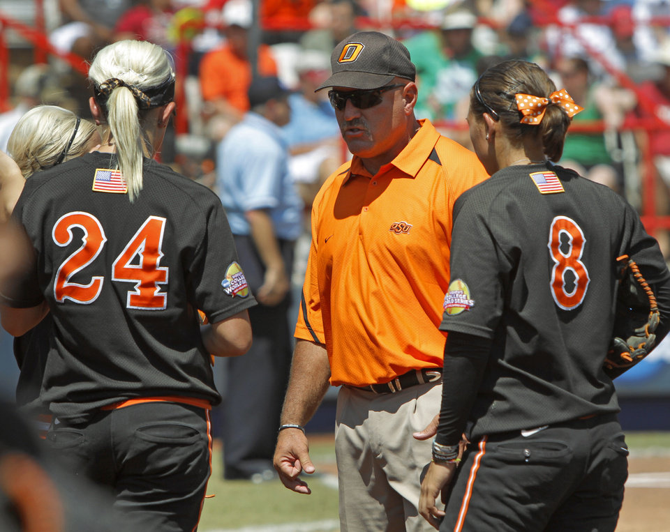 Photo - Oklahoma State coach Rich Wieligman talks with his players during a Women's College World Series softball game between Oklahoma State University and California at ASA Hall of Fame Stadium in Oklahoma City, Saturday, June 4, 2011. Photo by Bryan Terry, The Oklahoman