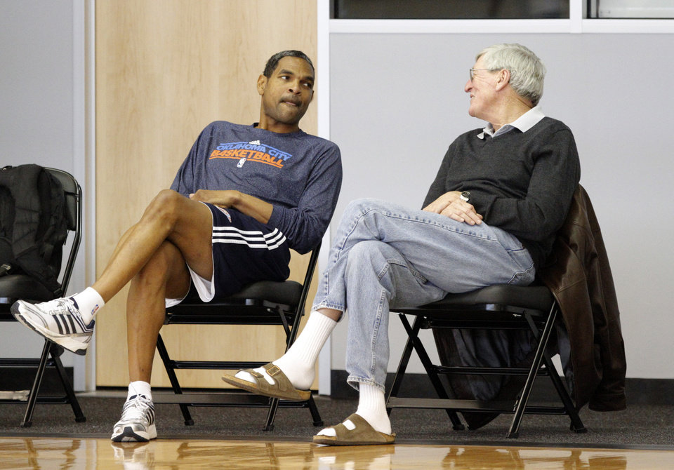 Photo - Oklahoma City's Maurice Cheeks talks with Hank Egan during the Thunder's practice in Oklahoma City, Sunday, Dec. 11, 2011. Photo by Sarah Phipps, The Oklahoman