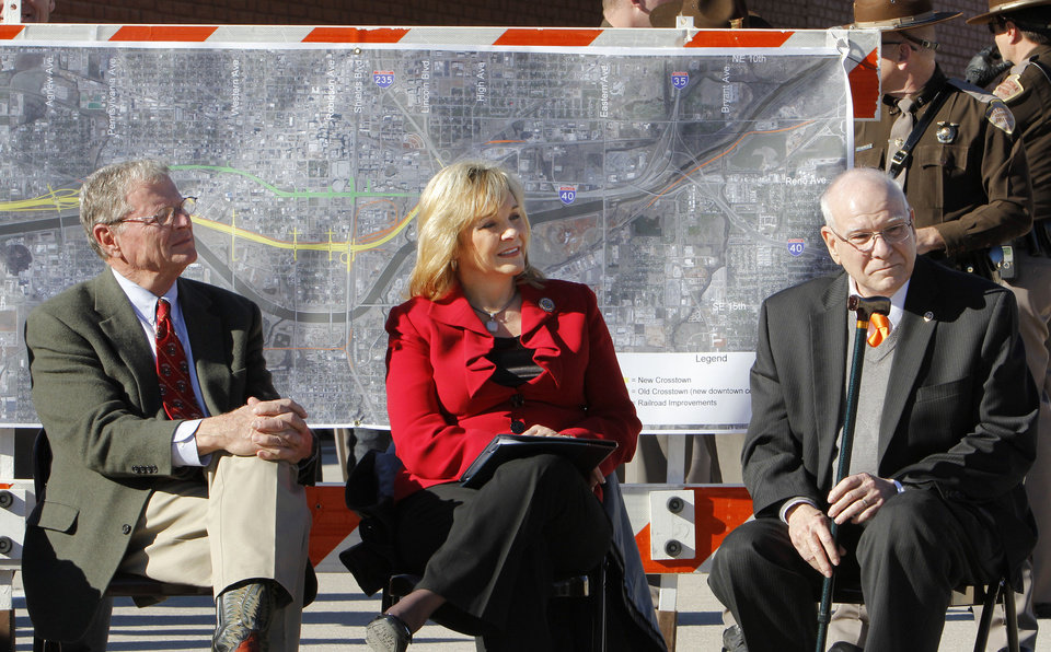 Sen. Jim Inhofe, Gov. Mary Fallin, and Gary Ridley, Oklahoma Secretary of Transportation, listen to a speaker during grand opening ceremonies for the east bound lanes of the I-40 Crosstown in Oklahoma City Thursday, Jan. 5, 2012. Photo by Paul B. Southerland, The Oklahoman ORG XMIT: KOD
