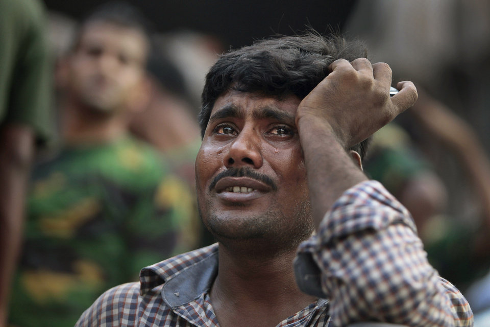 Photo - A Bangladeshi relative of a victim cries at the site of a building that collapsed Wednesday in Savar, near Dhaka, Bangladesh,Thursday, April 25, 2013. By Thursday, the death toll reached at least 194 people as rescuers continued to search for injured and missing, after a huge section of an eight-story building that housed several garment factories splintered into a pile of concrete.(AP Photo/A.M.Ahad)