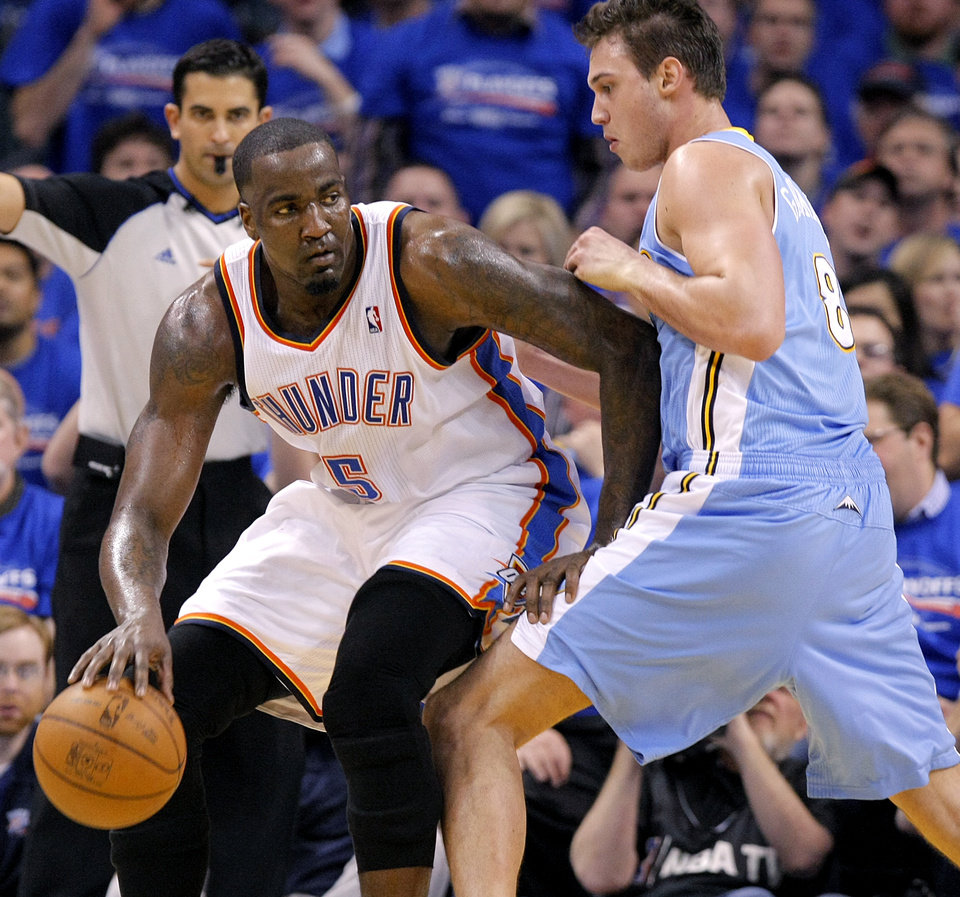 Oklahoma City\'s Kendrick Perkins (5) battles on the baseline with Denver\'s Danilo Gallinari (8) during the first round NBA playoff game between the Oklahoma City Thunder and the Denver Nuggets on Sunday, April 17, 2011, in Oklahoma City, Okla. Photo by Chris Landsberger, The Oklahoman