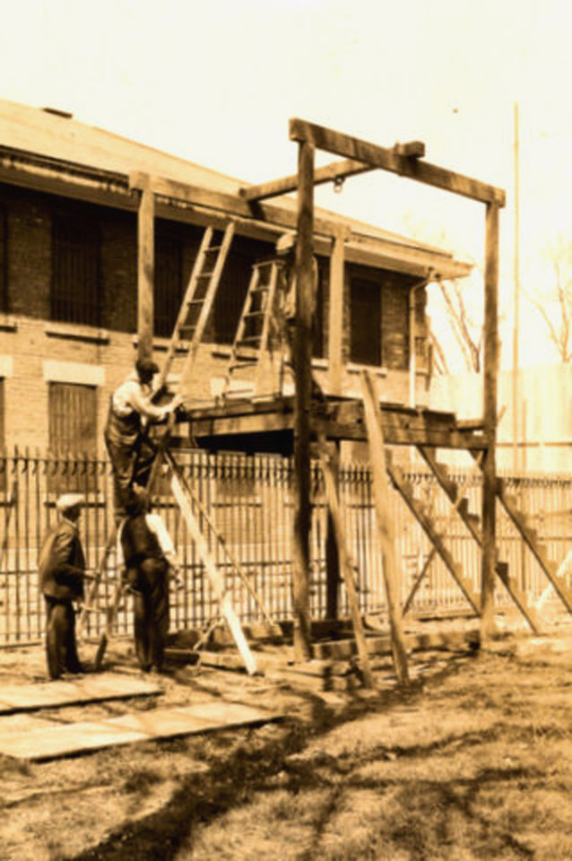 Photo - This 1928 photo provided by the Franklin County Historic Preservation Society in Benton, Ill., shows gallows being built for the hanging of bootlegging gangster Charlie Birger in Benton. Birger was the last person to be publicly hanged in Illinois. Administrators of the Franklin County Jail Museum in Benton got a call recently from a family that found the gallows in a barn in Grand Tower, Ill. The wood and rebar pieces of the apparatus have been moved to the museum, which has had to make do for years with a replica of the gallows. (AP Photo/Courtesy of the Franklin County Historic Preservation Society)