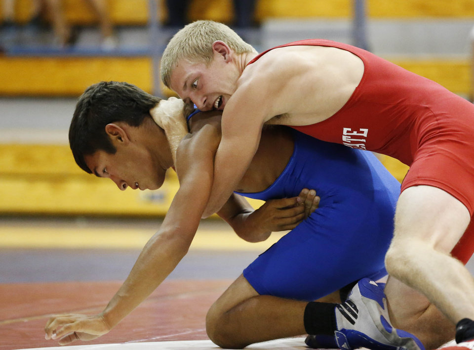 Photo - Berryhill's Trey Jimenez (in blue) on the small east team fights Sulphur's Ike Flowers on the west in the 113 weight fight during the All State Wrestling tournament at Bixby High School in Bixby, Okla., taken on July 31,2013. JAMES GIBBARD/Tulsa World
