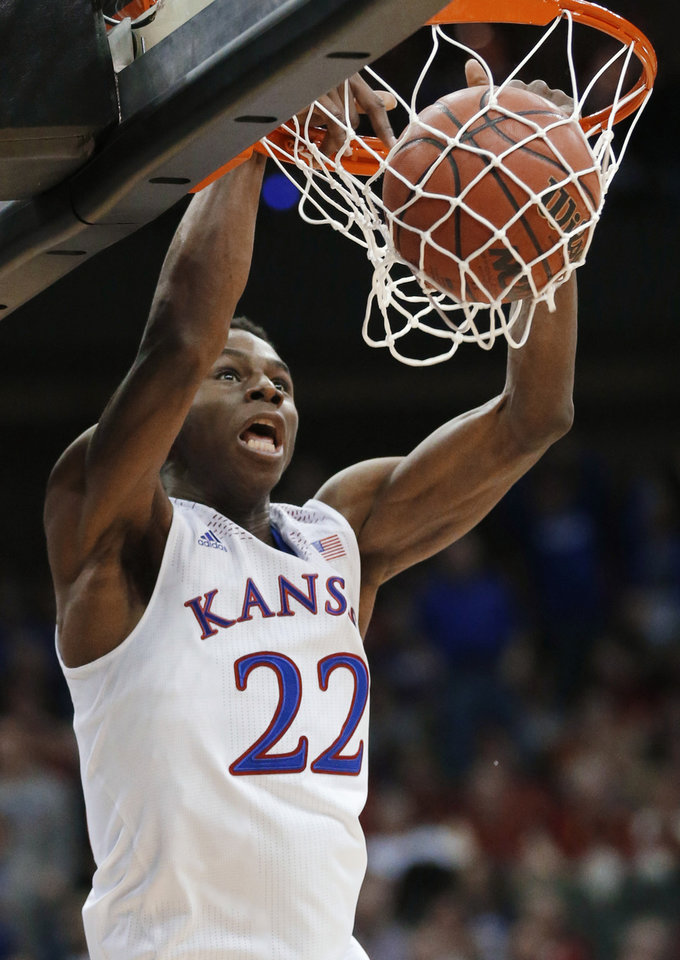 Photo - Kansas guard Andrew Wiggins dunks during the second half of an NCAA college basketball game against Oklahoma State in the quarterfinals of the Big 12 Conference men's tournament in Kansas City, Mo., Thursday, March 13, 2014. Kansas defeated Oklahoma State 77-70 in overtime. (AP Photo/Orlin Wagner)