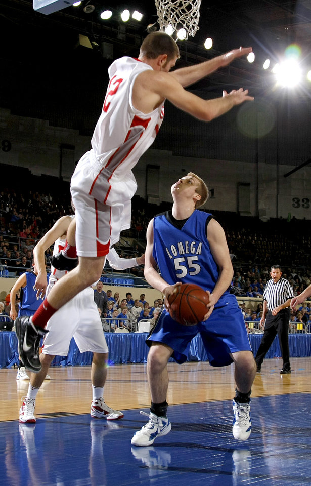 Forgan's Ryan Radcliff defends Lomega's Conlee Teel during the semifinal game of the Class B boys state basketball tournament at State Fair Arena in Oklahoma CIty, Friday, March 3, 2012. Photo by Bryan Terry, The Oklahoman