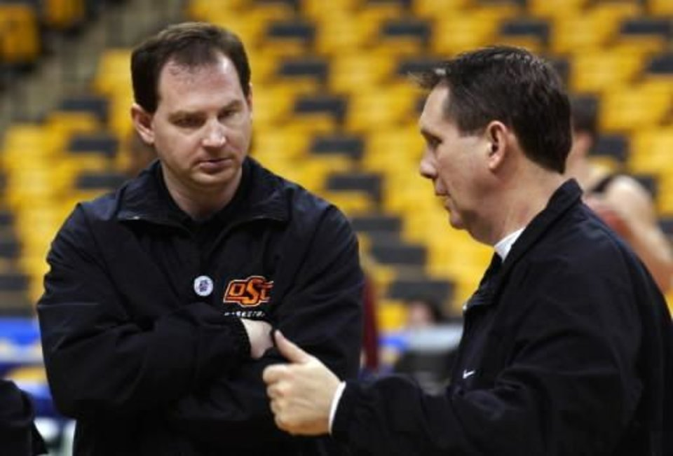 NCAA regional Boston: Oklahoma State assistant coaches Sean Sutton and James Dickey talk during practice at the Fleet Center at the start of the East Bracket of the NCAA tournament. Photo by Steve Sisney