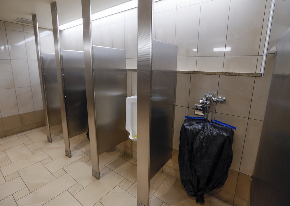 Photo - Every other stall is taped off in a restroom at Penn Square Mall during the re-opening of the mall after being closed because of the coronavirus pandemic, in Oklahoma City, Friday, May 1, 2020. [Nate Billings/The Oklahoman]