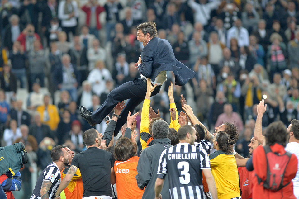 Photo - Juventus players lift their coach Antonio Conte as they celebrate at the end of a Serie A soccer match againsts Atalanta, at the Juventus stadium, in Turin, Italy, Monday, May 6, 2014. Juventus clinched its third straight and 30th overall Serie A title. (AP Photo/Massimo Pinca)