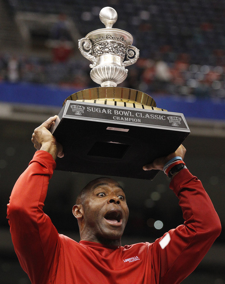 Louisville head coach Charlie Strong celebrates following a 33-23 win over Florida in the Sugar Bowl NCAA college football game Wednesday, Jan. 2, 2013, in New Orleans.  (AP Photo/Bill Haber)