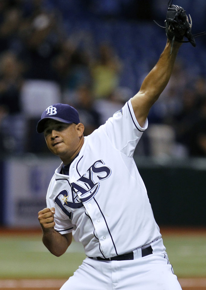 Photo -   Tampa Bay Rays relief pitcher Joel Peralta reacts after closing out the Seattle Mariners during the ninth inning of a baseball game, Wednesday, May 2, 2012, in St. Petersburg, Fla. The Rays won the game 5-4. (AP Photo/Chris O'Meara)
