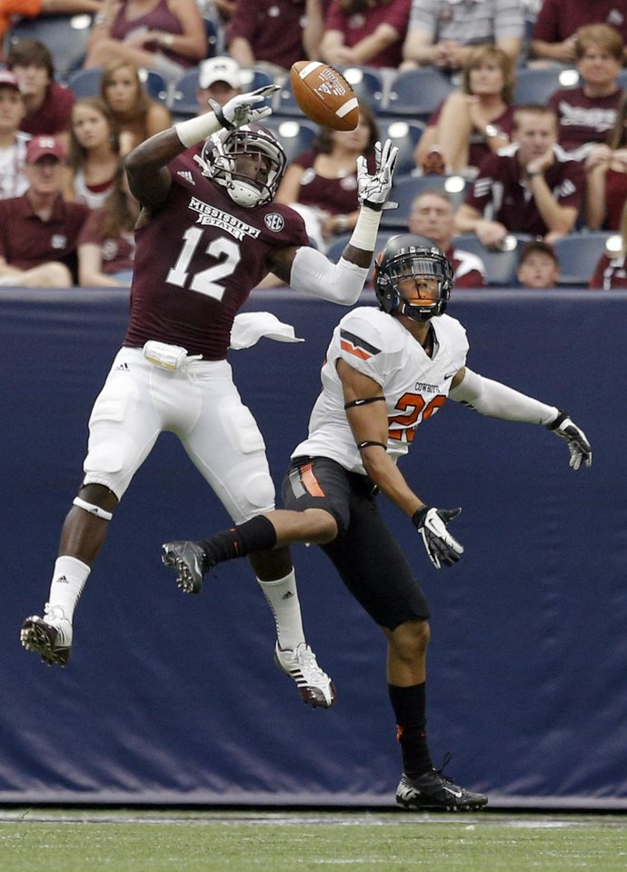 Oklahoma State's Tyler Patmon (26) breaks up a pass intended Mississippi State's Robert Johnson (12) during second half of the AdvoCare Texas Kickoff college football game between the Oklahoma State University Cowboys (OSU) and the Mississippi State University Bulldogs (MSU) at Reliant Stadium in Houston, Saturday, Aug. 31, 2013. Photo by Sarah Phipps, The Oklahoman