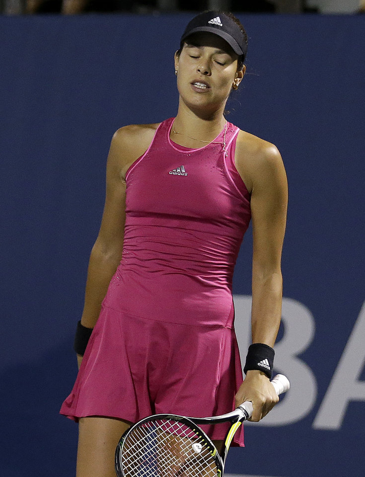 Photo - Ana Ivanovic, from Serbia, reacts after losing a point to Serena Williams during the third set of their match in the Bank of the West Classic tennis tournament in Stanford, Calif., Friday, Aug. 1, 2014. Williams won 2-6, 6-3, 7-5. (AP Photo/Jeff Chiu)