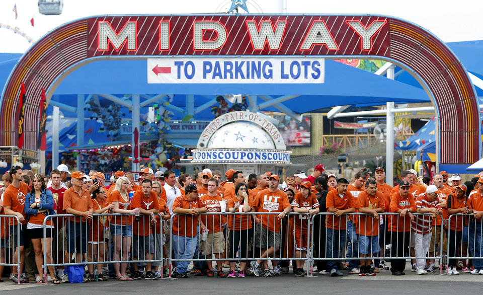 Texas fans wait for the team to arrive during the Red River Rivalry college football game between the University of Oklahoma Sooners (OU) and the University of Texas Longhorns (UT) at the Cotton Bowl Stadium in Dallas, Saturday, Oct. 12, 2013. Photo by Chris Landsberger, The Oklahoman