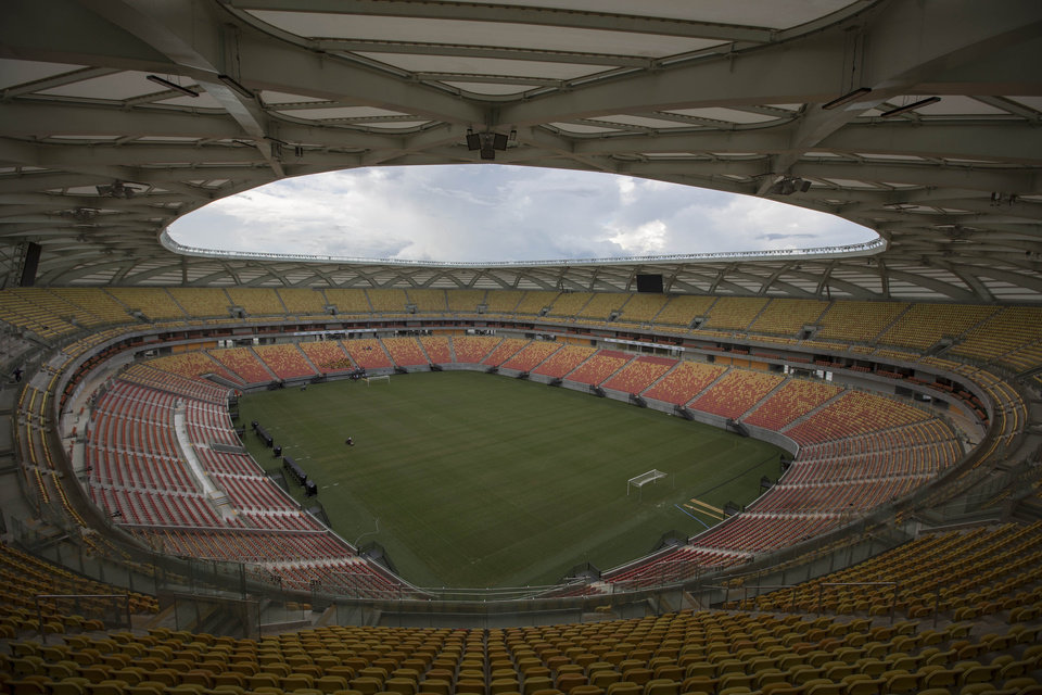 Photo - This May 20, 2014 photo shows the inside of of the Arena da Amazonia soccer stadium in Manaus, Brazil. It was supposed to have been finished in 2013, but even just three weeks before the start of World Cup play, crews were scrambling to finish wiring and other crucial work. The new 44,500-seat stadium, with its wicker basket-styled frame, would be a worthy field for any top-division soccer team _ if only Manaus actually had one to use it. (AP Photo/Felipe Dana)