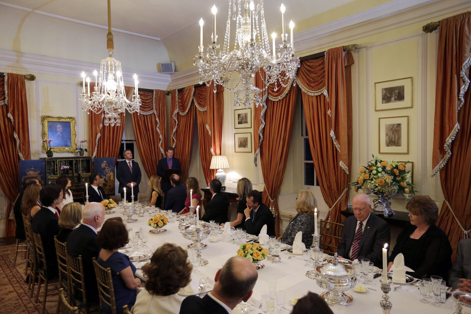 Photo - England's Prince Harry, standing right, with British Ambassador Sir Peter Westmacott, speaks at a dinner at the British Ambassador's residence, Thursday, May 9, 2013 in Washington. (AP Photo/Alex Brandon, Pool)