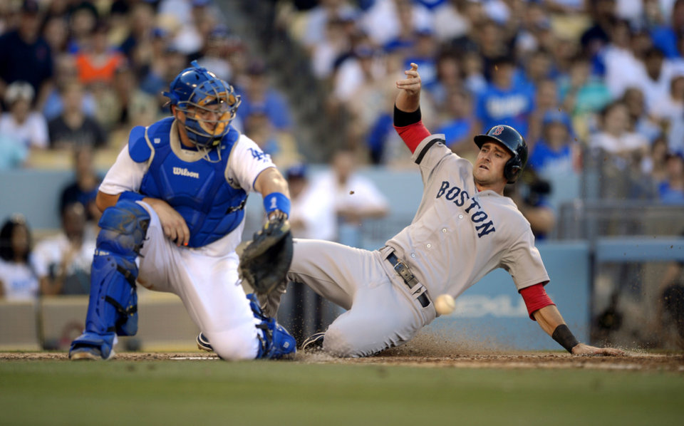 Photo - Boston Red Sox's Will Middlebrooks, right, scores on a double by Xander Bogaerts as Los Angeles Dodgers catcher A.J. Ellis takes a late throw during the fourth inning of their baseball game, Sunday, Aug. 25, 2013, in Los Angeles.  (AP Photo/Mark J. Terrill)