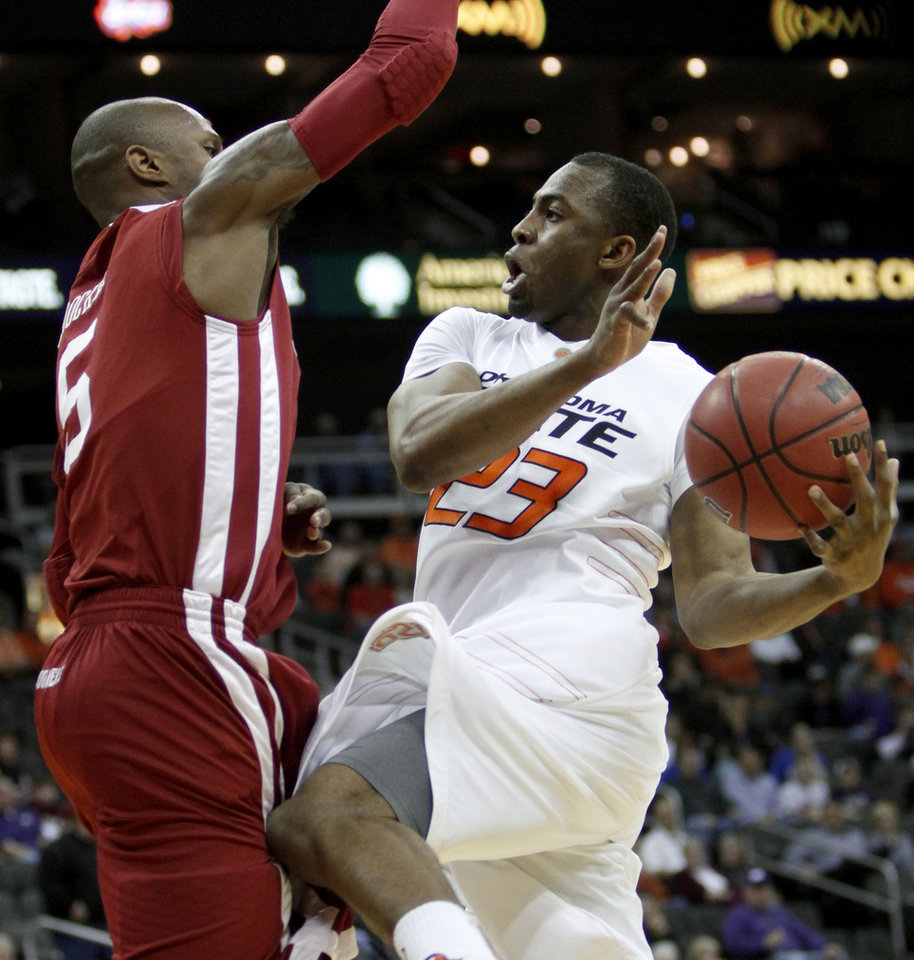 Photo - OSU's James Anderson drives toward OU's Tony Crocker in the first half of the college basketball game during the men's Big 12 Championship tournament at the Sprint Center on Wednesday, March 10, 2010, in Kansas City, Mo. Photo by Bryan Terry, The Oklahoman