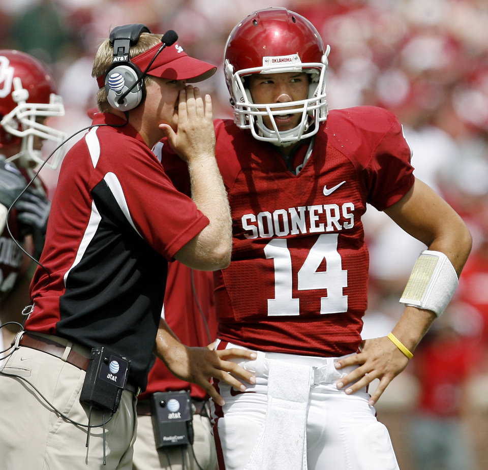Josh Heupel talks with Sam Bradford of OU in the second half during the University of Oklahoma Sooners (OU) college football game against the University of Miami Hurricanes (UM) at the Gaylord Family -- Oklahoma Memorial Stadium, on Saturday, Sept. 8, 2007, in Norman, Okla. By Bryan Terry, The Oklahoman