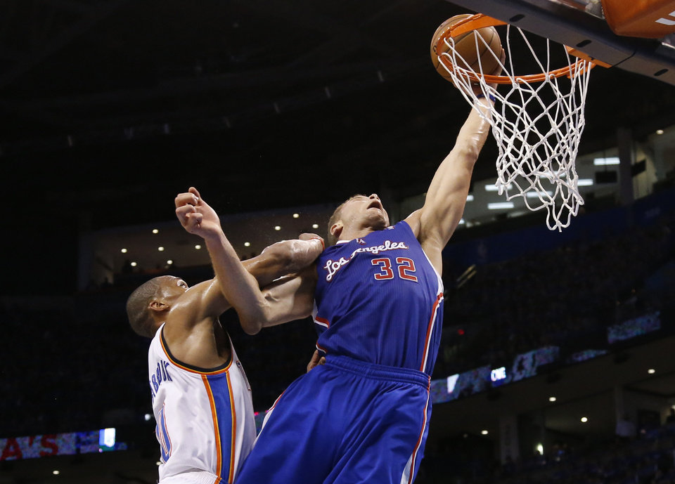 Photo - Los Angeles Clippers forward Blake Griffin (32) is fouled by Oklahoma City Thunder guard Russell Westbrook (0) as he shoots in the second quarter of Game 1 of the Western Conference semifinal NBA basketball playoff series in Oklahoma City, Monday, May 5, 2014. (AP Photo/Sue Ogrocki)