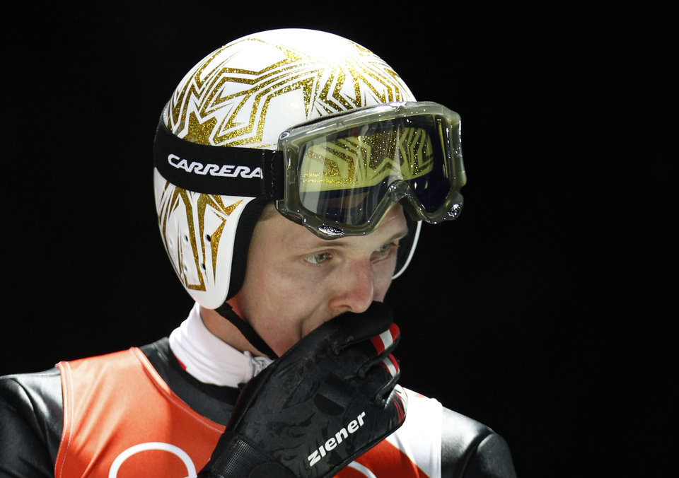 Photo - Austria's Thomas  Morgenstern prepares for an attempt in training for the men's normal hill ski jumping at the 2014 Winter Olympics, Thursday, Feb. 6, 2014, in Krasnaya Polyana, Russia. (AP Photo/Matthias Schrader)
