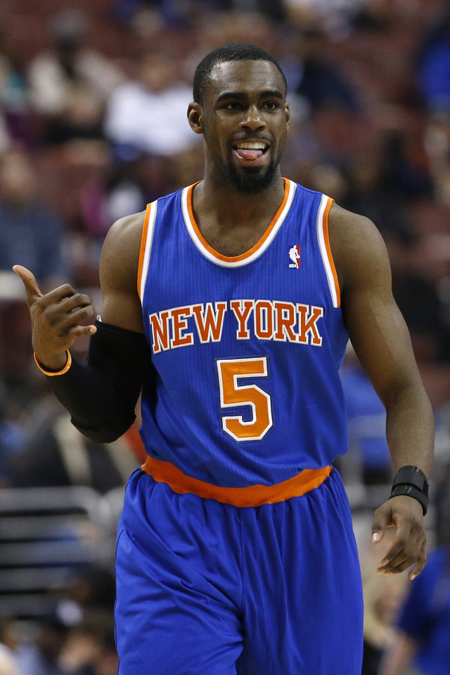 Photo - New York Knicks' Tim Hardaway Jr. reacts after making a three-point basket during the second half of an NBA basketball game against the Philadelphia 76ers, Friday, March 21, 2014, in Philadelphia. New York won 93-92. (AP Photo/Matt Slocum)