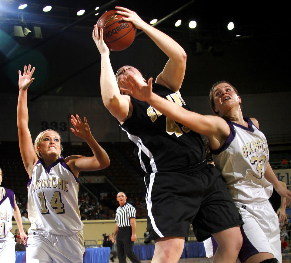 Photo - Seiling's Kari Trammell grabs a rebound between Okarche's Macy Kunneman, left, and Megan Schaefer during the Class A girls basketball state tournament at the State Fair Arena in Oklahoma City, Friday, March 5, 2010.  Photo by Bryan Terry, The Oklahoman