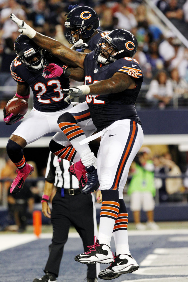 Photo -   Chicago Bears wide receiver Devin Hester (23) celebrates his touchdown against the Dallas Cowboys with Brandon Marshall (15) and Chilo Rachal (62) during the second half of an NFL football game, Monday, Oct. 1, 2012, in Arlington, Texas. (AP Photo/LM Otero)