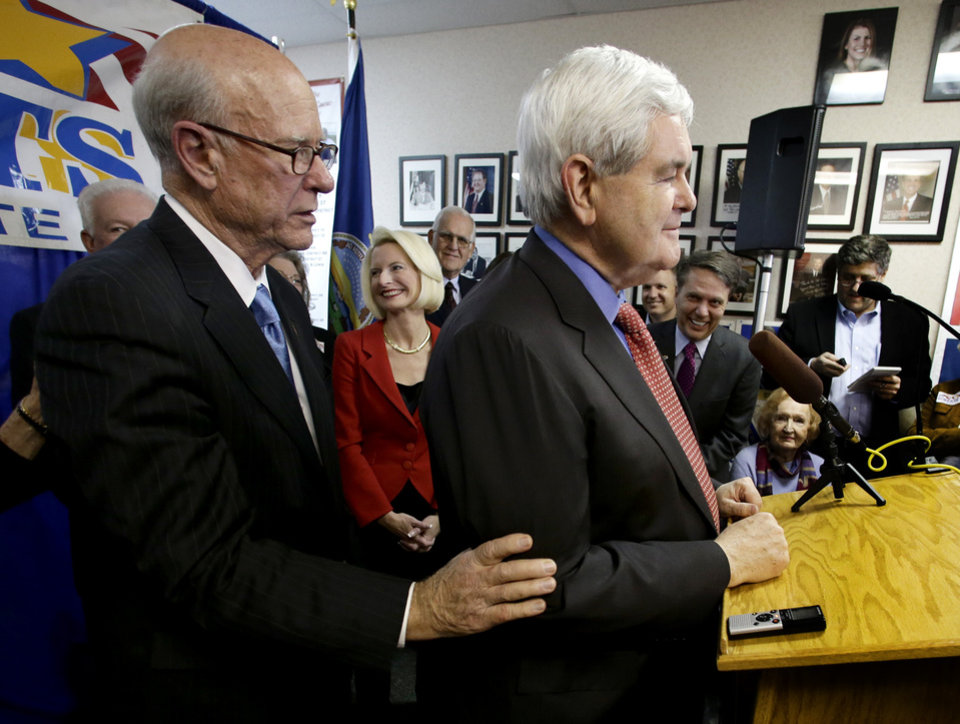 Photo - Former U.S. House Speaker Newt Gingrich, right, campaigns for U.S. Sen. Pat Roberts, left, during a  campaign appearance Friday, Nov. 8, 2013, in Overland Park, Kan. (AP Photo/Charlie Riedel)