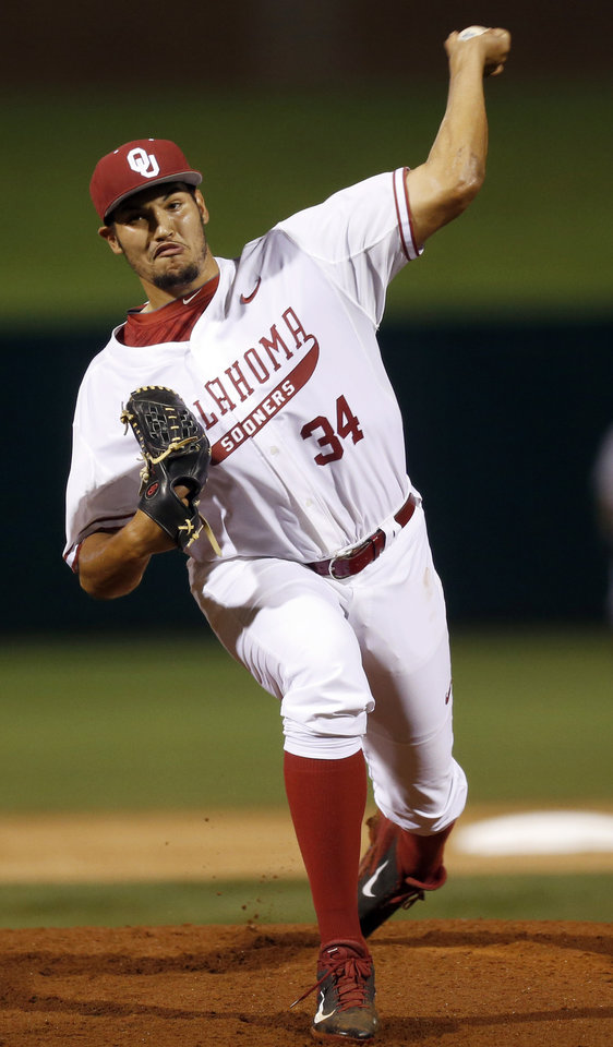 Photo - OU's Adam Choplick (34) pitches during a Bedlam college baseball game between Oklahoma and Oklahoma State in the Big 12 baseball tournament at the Chickasaw Bricktown Ballpark in Oklahoma City,  Friday, May 23, 2014. Photo by Nate Billings, The Oklahoman