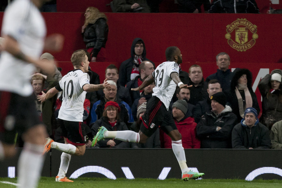 Photo - Fulham's Darren Bent, centre, celebrates after scoring an injury time goal against Manchester United during their English Premier League soccer match at Old Trafford Stadium, Manchester, England, Sunday Feb. 9, 2014. (AP Photo/Jon Super)