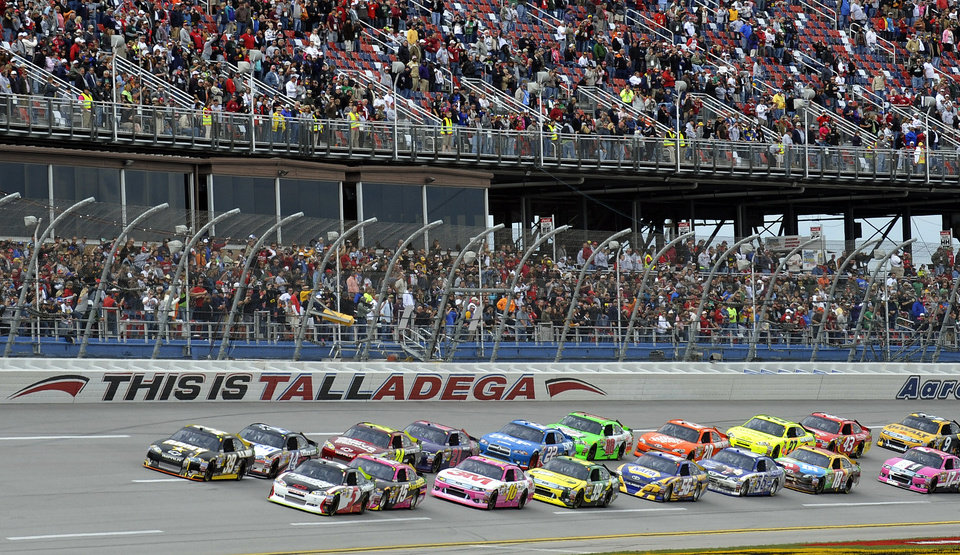 Kasey Kahne (5) leads the field to the start during the Good Sam Club 500 NASCAR Sprint Cup auto race at Talladega Superspeedway in Talladega, Ala., Sunday, Oct. 7, 2012. (AP Photo/Rainier Ehrhardt)
