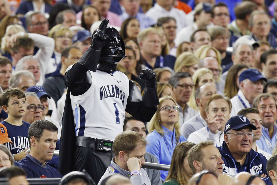 Photo - A Villanova fan in a Darth Vader costume stands near the end of the national semifinal between the Oklahoma Sooners (OU) and the Villanova Wildcats in the Final Four of the NCAA Men's Basketball Championship at NRG Stadium in Houston, Saturday, April 2, 2016. Photo by Nate Billings, The Oklahoman